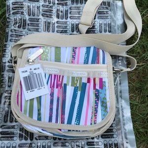 Small Le Sportsac shoulder bag in stripe pattern.